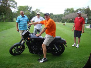 Steve Jones on the Harley w his foursome 8-10-15