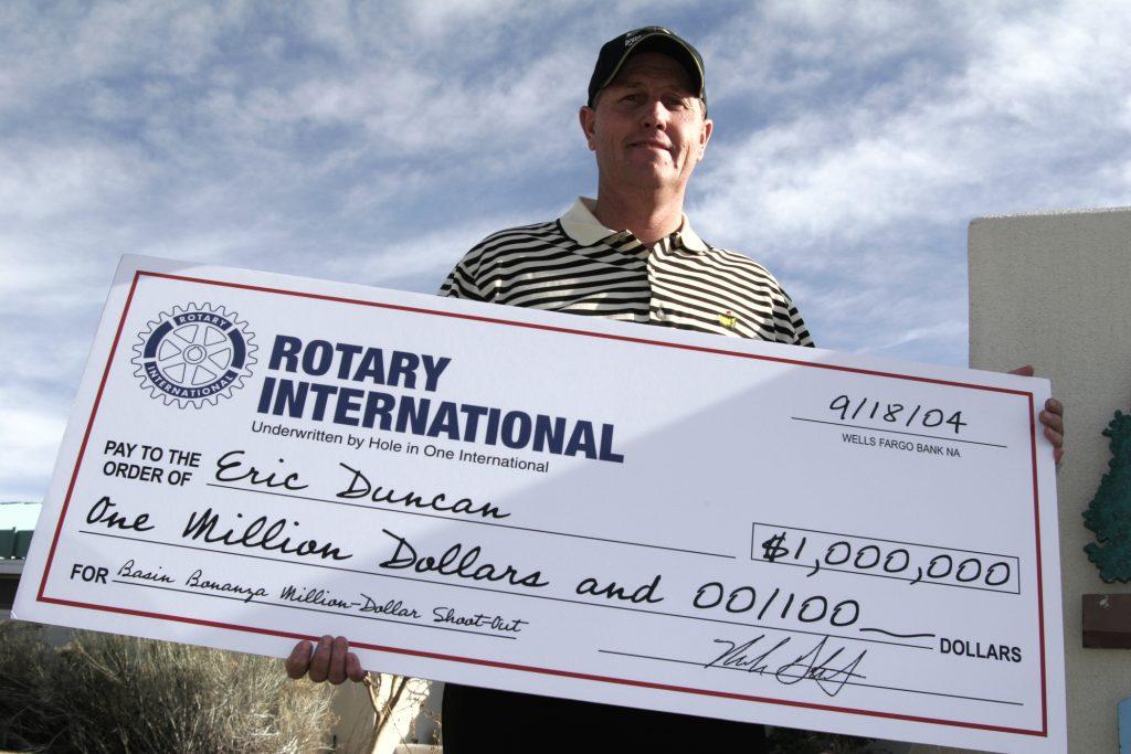 million dollar winner with check